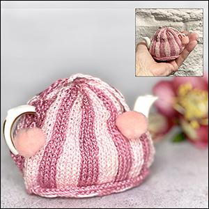 Pink striped miniature tea cosy