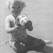 Child in knitted swimsuit